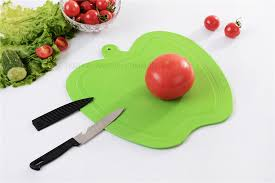 Chopping board with knife apple