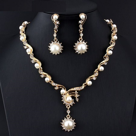 African Woman Gold and Pearl Necklace With a Set of Earrings