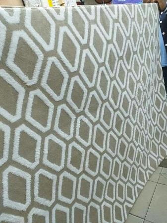 Soft rugged carpets grey