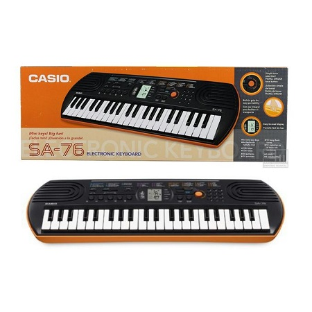 Casio Mini-Children Musical Keyboard Piano With A Free Power Supply Unit